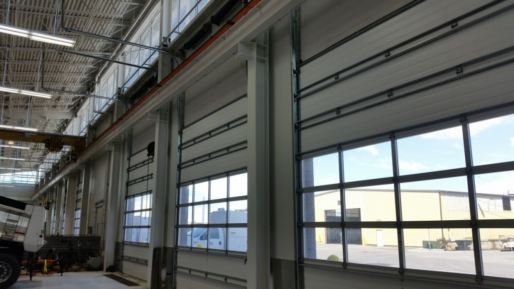The aluminum full view sections allow natural light to enter the interior workspace.