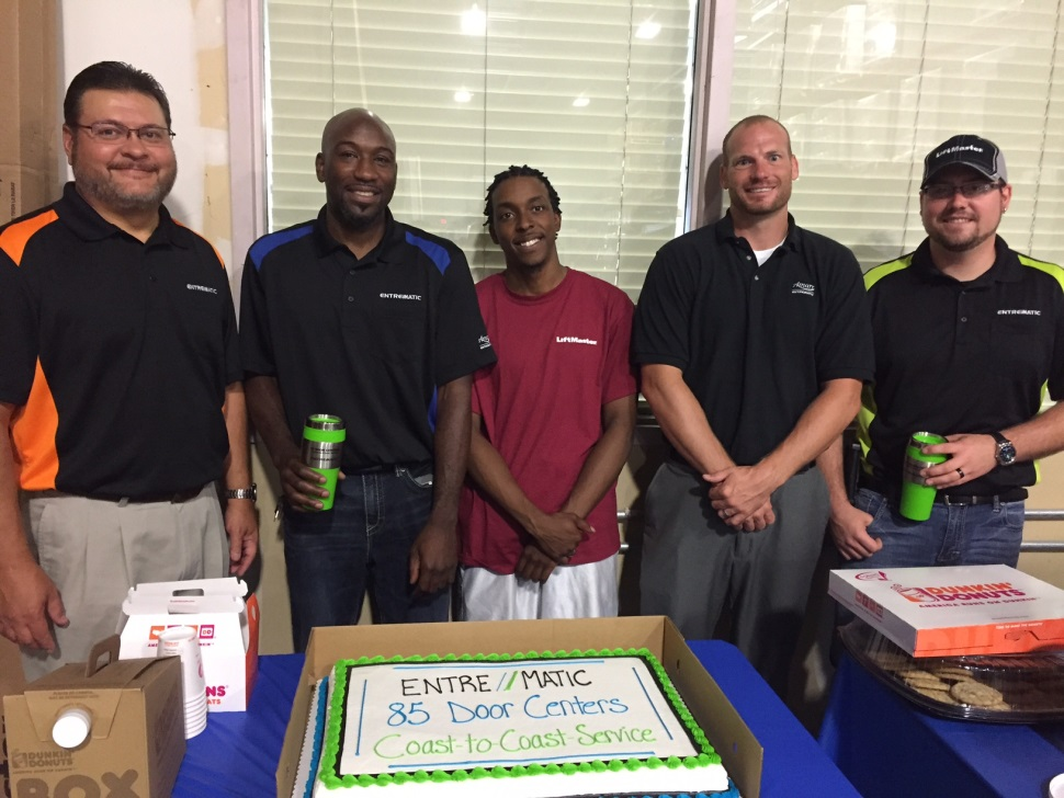 Kansas City Team Members pose with their Open House cake. Pictured from Left to Right: John Henderson, District Service Manager; Shannon Brown, General Manager; Dewan White, Warehouse; Drew Reno, Sales Manager; Luke Whittemore, Service Manager.
